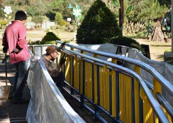 BAGUIO. Workers complete the repainting job at the children's park in Burnham Park. Park goers are encouraging the City Government to pour more budget for the maintenance and repair of the facilities. (Redjie Melvic Cawis)