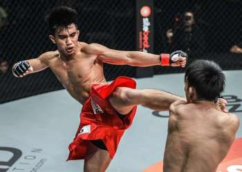 INDONESIA. Joshua Pacio lands a kick against Yasuke Saruta in their championship match in Jakarta, Indonesia. Pacio fell short of retaining his ONE Championship strawweight world championship belt against Saruta via split decision. (One Championship photo)