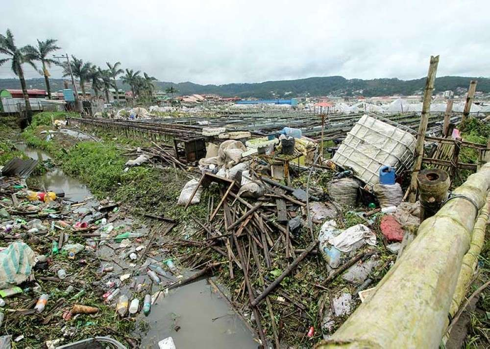 BENGUET. Debris from shattered stalls, plant covers and plastic wastes are scattered along a canal at the La Trinidad strawberry farm. The farm was flooded when Typhoon Ompong struck. Farmaers said it was the worst storm they have experienced. (Jean Nicole Cortes/SunStar)