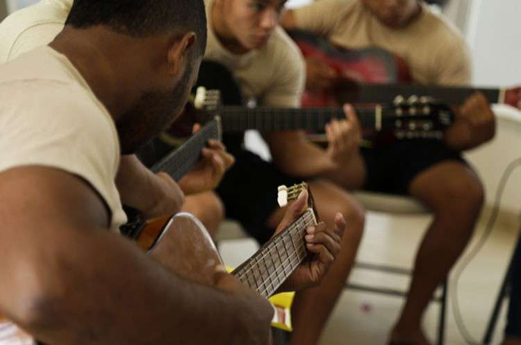 PANAMA. A group of young inmates play guitars during choir practice at the Las Garzas de Pacora detention center,  Panama, Wednesday, January 16. The group rehearsed the World Youth Day hymn at the entrance to the school. One boy  played the piano, others strummed guitars and still others formed the chorus, coached by volunteers ahead of a planned performance for the pontiff. (AP)