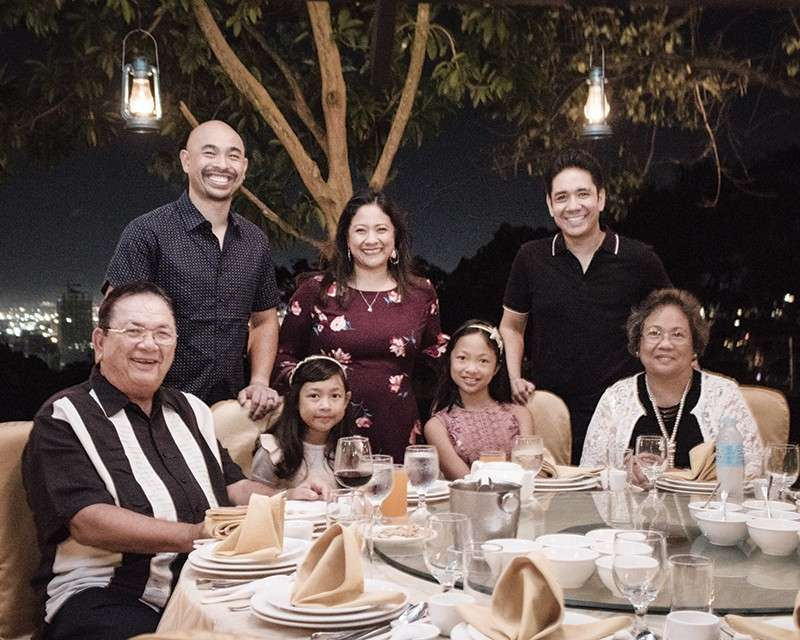 "FAMILY TIME. San Francisco-based Ricardo ""Boy"" Tan (seated left) wife Virgie (right) with grandaughters Serena and Lexie. At the back are son-in-law Adrian Sangalang, daughter Lally and son Richard."