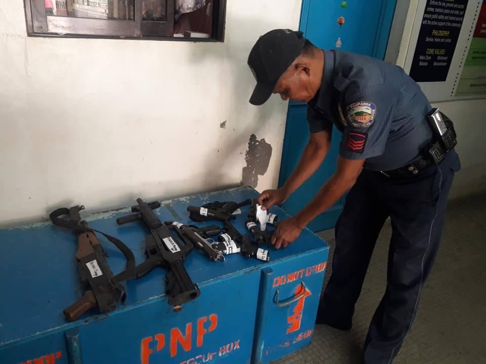 PAMPANGA. A member of the Masantol police documents the unlicensed firearms recovered from their owners during Oplan Katok. (Contributed photo)