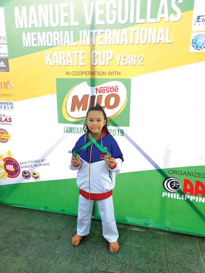 DAVAO. Atsuko Kaiyel Tan of the Association for the Advancement of Karatedo (AAK) Davao poses with her two gold medals won in the recently-concluded 2nd Manuel Veguillas Memorial Cup at SM Mall of Asia Music Hall in Pasay City. (Rommel Tan)