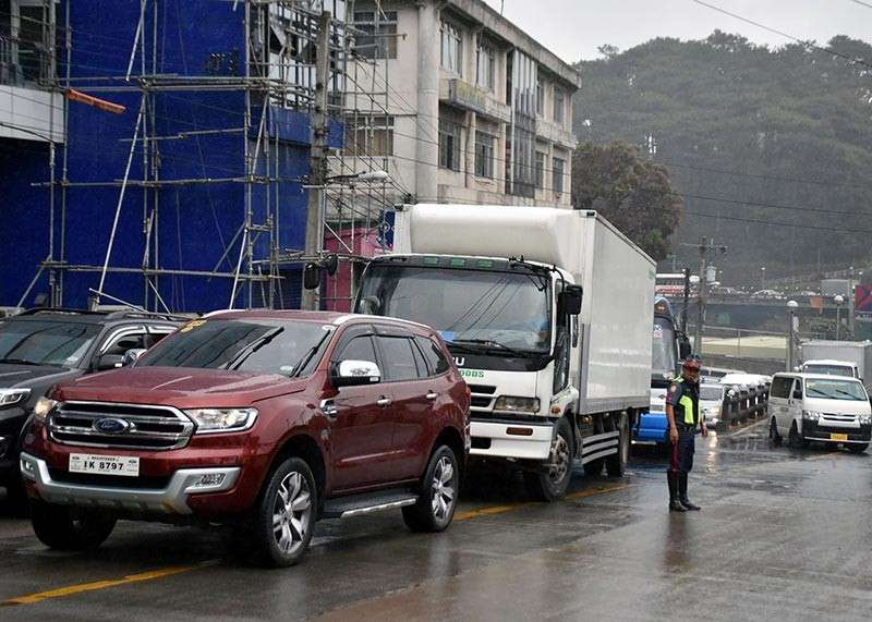 BAGUIO. A Highway Patrol Group officer manage traffic flow along the BGH Flyover particularly for vehicles moving towards Marcos Highway as congestion continue to hound the city especially during the holidays and long weekends. (Redjie Melvic Cawis)