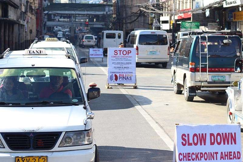 BAGUIO. Authorities conduct daily check point along the city's main thoroughfares to intensify their campaign for a peaceful 2019 midterm election. (Jean Nicole Cortes)