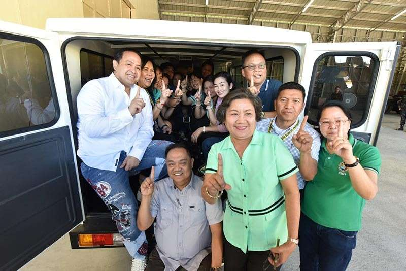 "PAMPANGA. Acting Governor Dennis ""Delta"" Pineda joins Provincial School Superintendent Dr. Leonardo ""Ding"" Zapanta and the 16 public school district supervisors during the initial distribution of brand new school service vehicles. (Contributed by Pampanga PIO)"