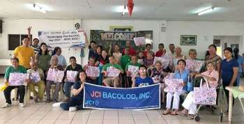 BACOLOD. The lolos and lolas of St. Vincent's Home receive their gifts from Junior Chamber International Bacolod Inc. team. (Contributed photo)