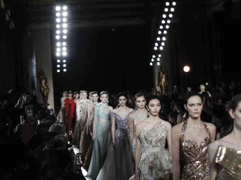 Models wear creations for the Elie Saab Spring/Summer 2019 Haute Couture fashion collection presented in Paris,  Jan. 22.  (AP Photo)