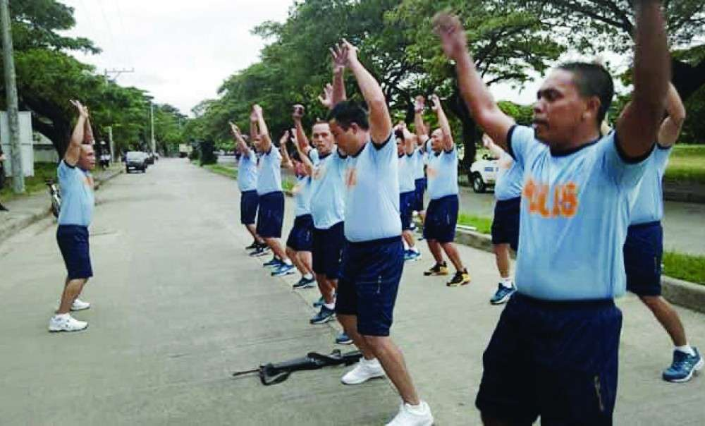 GUNNING FOR HEALTH. Consolacion Police Chief Gerard Ace Pelare leads his personnel in a physical exercise. The police official envisions a healthy force  in the town. (Contributed photo)