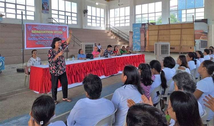 EASTERN SAMAR. Rina Reyes, project coordinator of land rights group Rights Network, delivers her speech during the graduation ceremony of 169 shelter rights claimants in Eastern Samar who received their skills training certificates from Tesda on January 23, 2019. (Contributed photo)