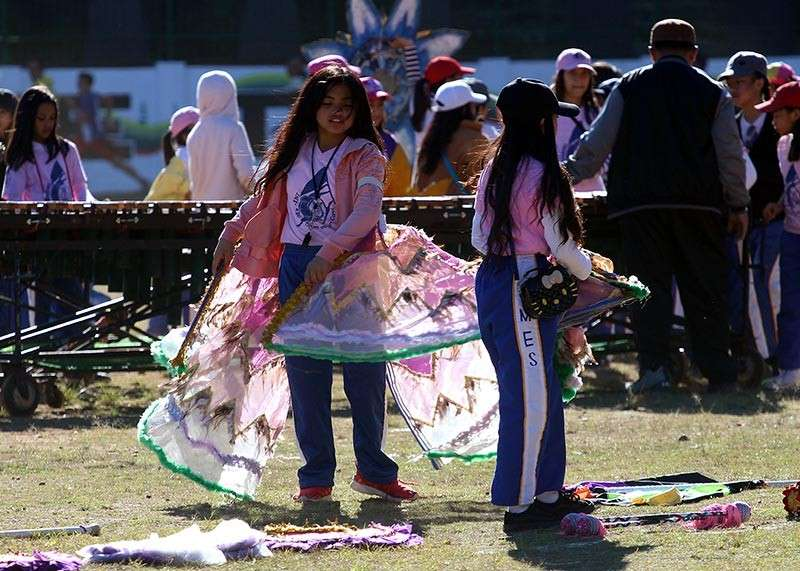 BAGUIO. Students of Mabini Elementary School practice at the open field of the Baguio Athletic Bowl for the opening of the Panagbenga on February 1. (Photo by Jean Nicole Cortes)