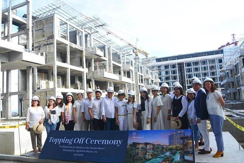 ALMOST DONE. AppleOne Properties officials and staff top off their project, The Residences at the Sheraton Mactan Cebu Resort, on Thursday, Jan. 24. (SunStar photo / Allan Cuizon)