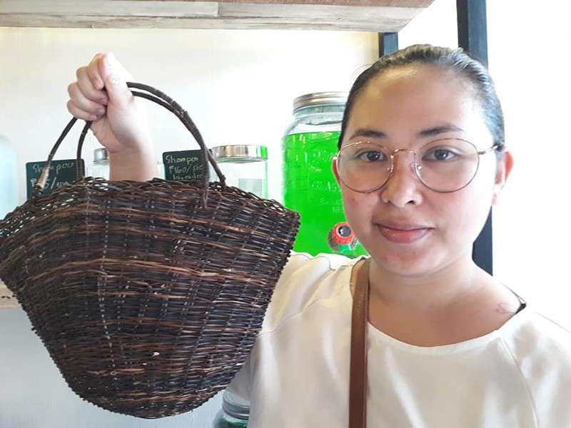 Blogger Mea Pabiona holds up a nito basket sold at Wala Usik. (Betsy Gazo)