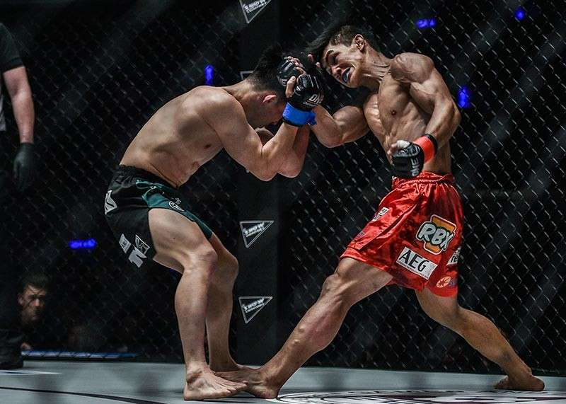MANILA. Danny Kingad showcases his striking prowess against Japan's Tatsumitsu Wada during ONE Championship's Heroes Ascent at the Mall of Asia Arena Friday evening to earn unanimous decision win. (ONE Championship photo)