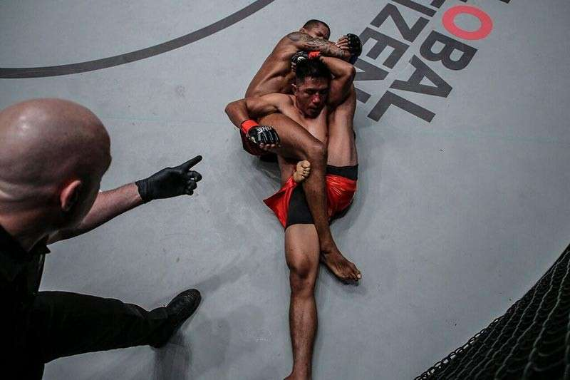 BAGUIO. Adriano Moraes nearly submits Geje Eustaquio in the fourth round of their championship match at the Mall of Asia Arena with a rare submission called a Suloev Stretch. (ONE Championship photo)