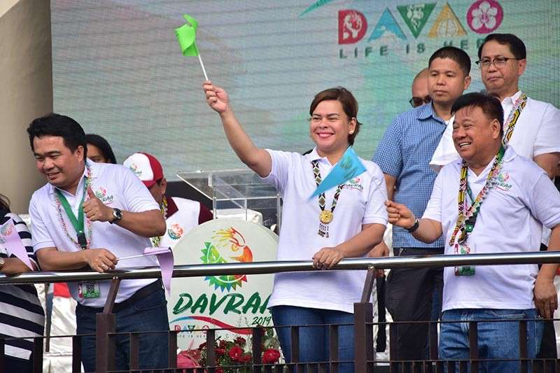 DAVAO. Davao City Mayor Sara Duterte Carpio acknowledges the Davao City delegates during the Davraa Meet 2019 opening parade with a a big smile and a wave of a flaglet she is holding. (Photo by Macky Lim)