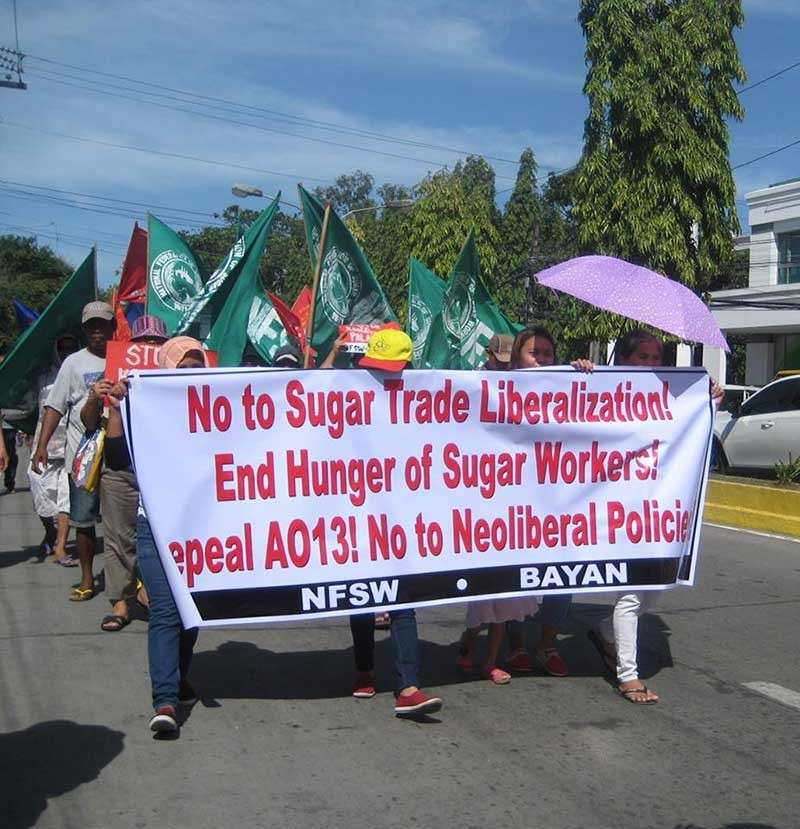 BACOLOD. Members of the militant groups in Negros Occidental stage a protest on Monday, January 28, opposing the proposed sugar liberalization as it will the sugar industry. (Contributed photo)