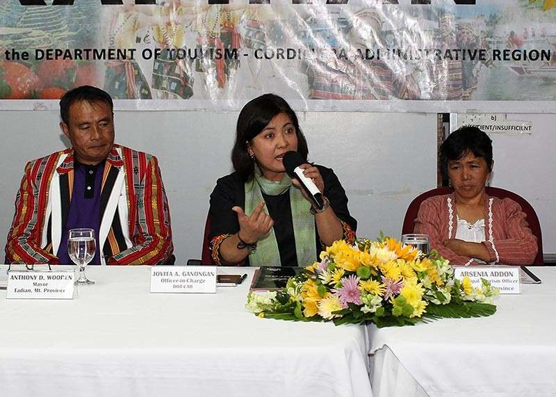 BAGUIO. Department of Tourism Cordillera officer in charge Jovy Ganongan (center) explains to the media on the crafting of a strategic farm tourism development plan seen to boost sustainable farm tourism and food security in the Cordillera during a press conference. Also in the photo are Bauko Mountain Province tourism officer Arsenia Addon and Tadian Mayor Anthony Wooden. (Photo by Jean Nicole Cortes)