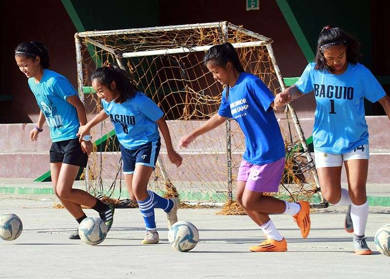 BAGUIO. Members of the Baguio women's futsal team composed of 10 players from Baguio City National High School and two from Guisad Valley National High School train at the athletic bowl in preparation for the Caraa meet on February 27 in Apayao. Baguio's futsal team ranked fourth place in last year's Palarong Pambansa. (Jean Nicole Cortes)