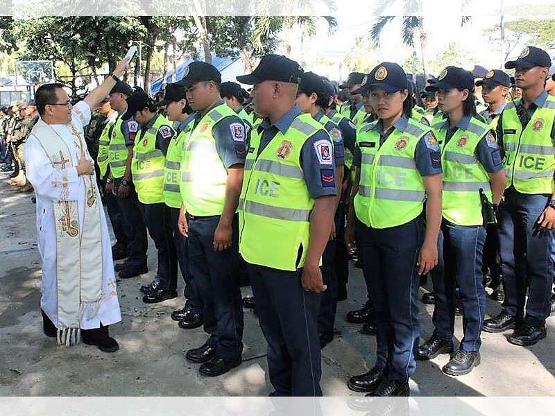BACOLOD. A priest blesses the augmentation personnel from Police Regional Office- Western Visayas during the send-off ceremony for the Bacolaodiat Festival at the Bacolod City Police Office headquarters on Thursday, January 31. (Contributed photo)