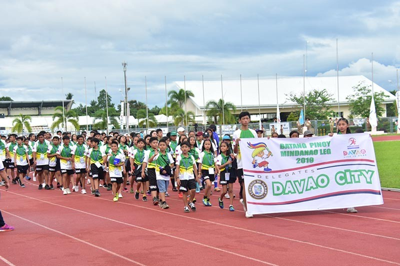 DEFENDING CHAMPION. Davao City delegates, who will try to defend the overall title, enter the Davao del Norte Sports and Tourism Complex during the opening ceremonies of the Batang Pinoy 2019 Mindanao Leg in Tagum City on Sunday, February 3. (Macky Lim)