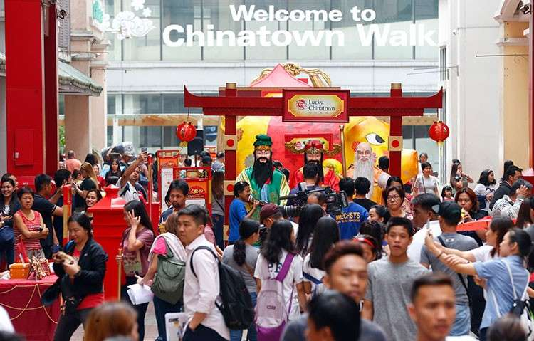 MANILA. People gather at the Lucky Chinatown Plaza to take part in the