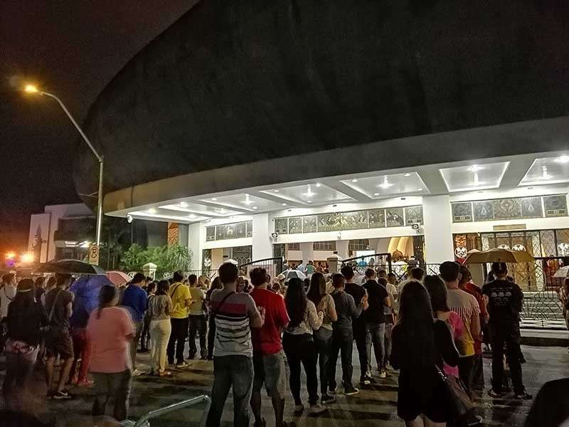 DAVAO. Churchgoers were forced to hear Mass outside San Pedro Cathedral after they were not allowed to enter the church for bringing bags bigger than a small purse. (Photo by Beverly Imbo Jimenez)