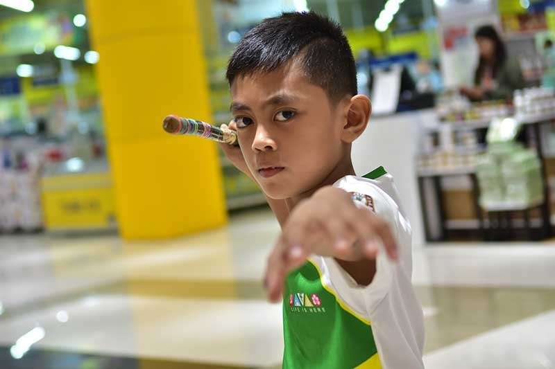 DAVAO. Ten-year-old Aethan Razy Fujita wins a gold medal in Batang Pinoy 2019 Mindanao leg arnis competition held at City Mall, Tagum City. This is the first gold for defending overall champion Davao City as of 4 p.m. Monday, February 4. (Macky Lim)