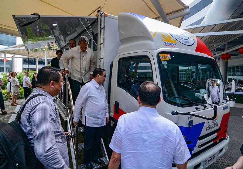 Passport on wheels. Foreign Affairs Secretary Teodoro Locsin Jr. inspects one of two mega vans at the SM Seaside City. Each van is equipped with eight data capturing machines that can process 800 to 1,000 passport applications a day. The vans will be at the SM Seaside City until March 2 to cater to passport applicants from Cebu and other parts of the Visayas. (SunStar Photo/Arni Aclao)