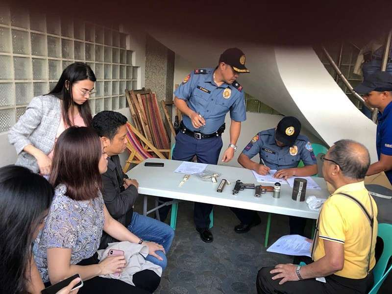 ALBAY. In this file photo, Daraga Mayor Carlwyn Baldo (seated, third from left) observes as police officers conduct an inventory of the alleged guns and ammunition found in his residence on Tuesday, January 22, 2019. (Contributed by Bicol Police Regional Office Director Arnel Escobal)