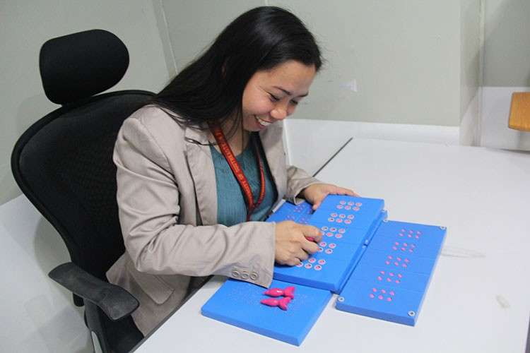 DAVAO. Sarrah Mae Villoria created the Brailliance, a modified Braille for individuals who are blind or visually impaired. (Kathleen Pastrana)