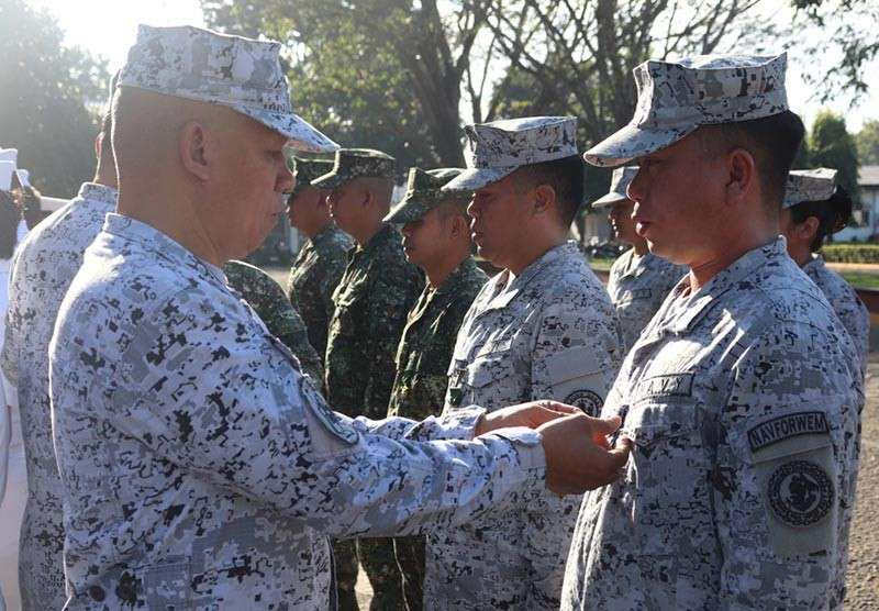 ZAMBOANGA. Rear Admiral Rene Medina, Naval Forces Western Mindanao command chief (left), pins medal to a sailor during the Donning of Ranks and Awards on Monday, February 4, at the Naval Station Romulo Espaldon. (Contributed photo)