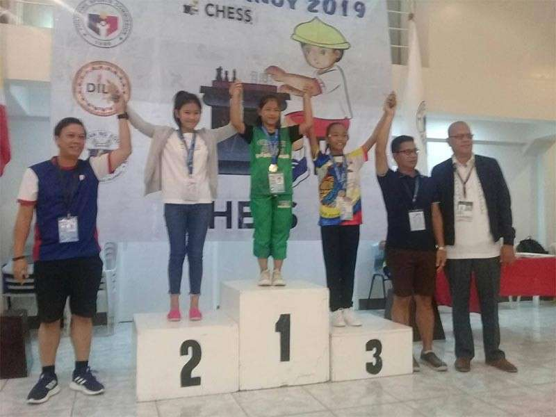 "TAGUM CITY. Ruelle ""Tawing"" Canino of Kauswagan Elementary School takes the podium after giving Cagayan de Oro's first gold in rapid chess of the ongoing 2019 Batang Pinoy Mindanao Leg games in Tagum City. (Supplied Photo)"