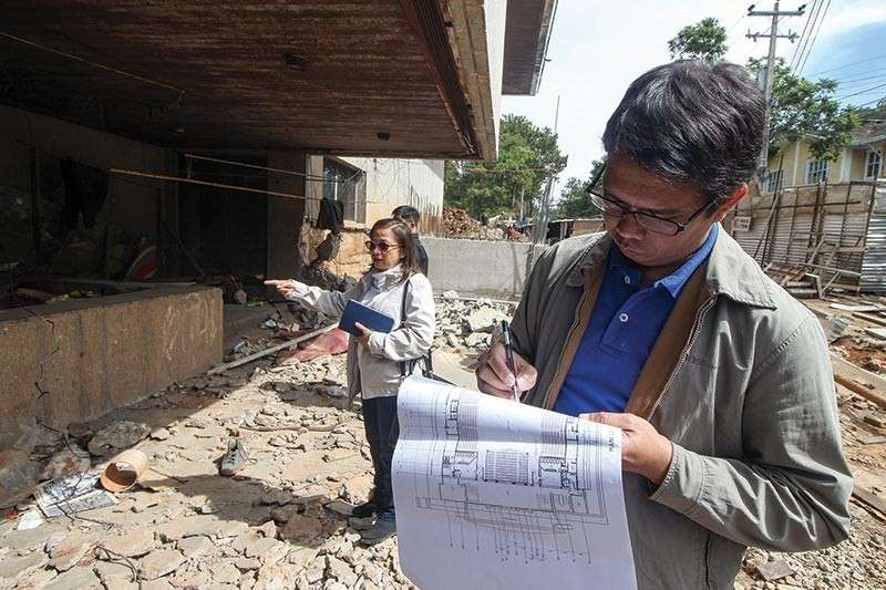 BAGUIO. Architect Johndy Pico (right) of the Department of Public Works and Highways (DPWH) and Baguio City Councilor Mylen Yaranon inspect the progress of the Baguio Convention Center rehabilitation. (Jean Nicole Cortes)