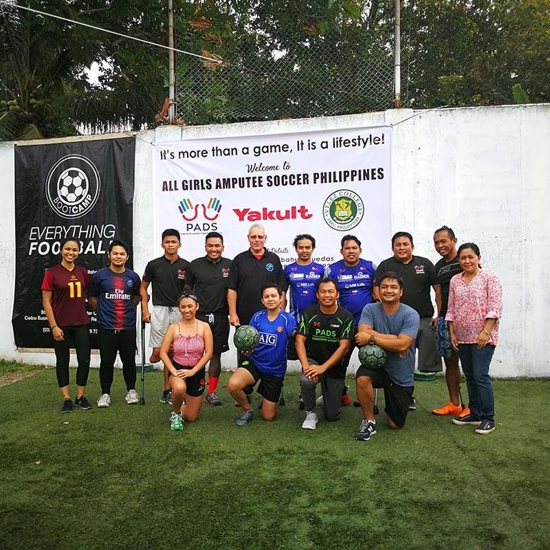 "NEW SPORT. Some of the players of amputee football pose alongside members of Pads after its first clinic that was headed by Christine ""Tynee"" Cabahug Ruedas (right). (Contributed photo)"