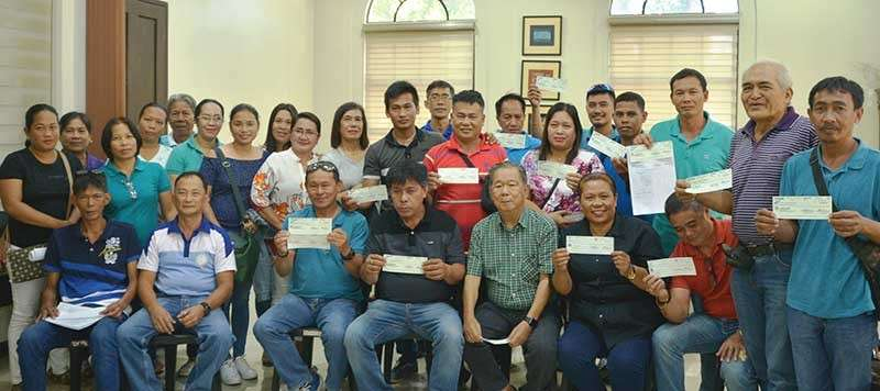 NEGROS. Governor Alfredo Marañon Jr. (seated, 3rd from right) leads the turnover of checks for barangay infrastructure projects at the Provincial Capitol recently. (Contributed photo)