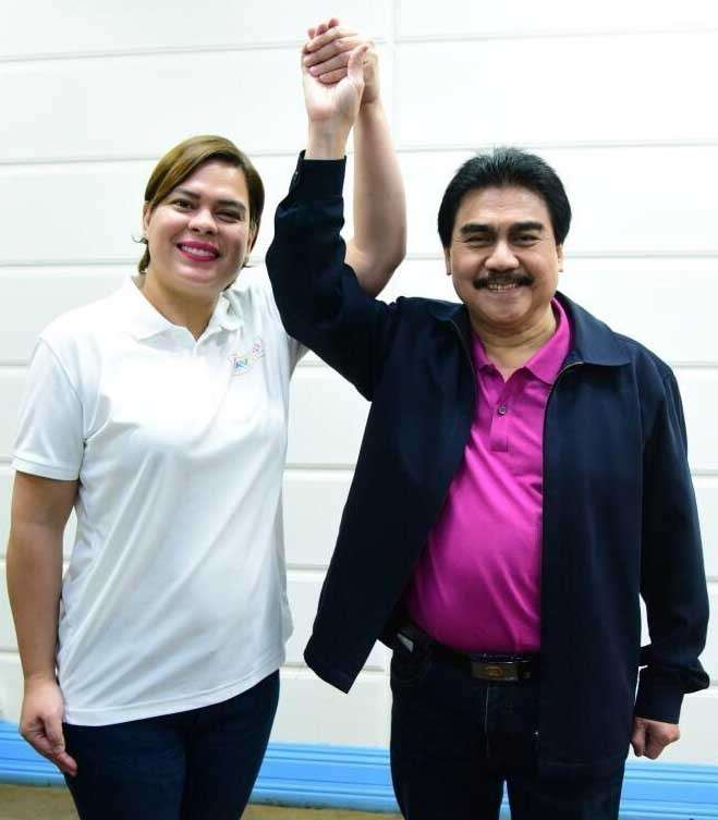 DAVAO. Presidential daughter and Davao City Mayor Sara Duterte-Carpio raises the hand of Bacolod Mayor Evelio Leonardia at the Davao City Hall to endorse his re-election in the May 13 elections. (Contributed photo)