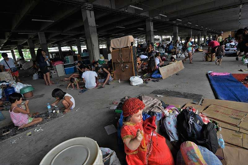 CEBU. Some of the victims of the Barangay Ermita fire on Tuesday, February 5 are now  staying at the Carbon Public Market Unit 2. (SunStar Photo/Amper Campaña)