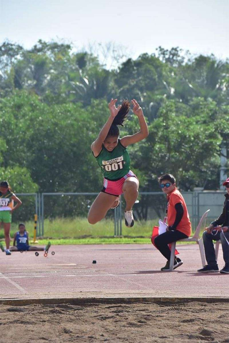 CAGAYAN DE ORO. Fourteen-year-old Rona Bacus of Balubal National High School takes CDO's first gold in athletics via 11.01 time effort in girls triple jump in 2019 Batang Pinoy Mindanao. (Macky Lim/Contributed Photo)