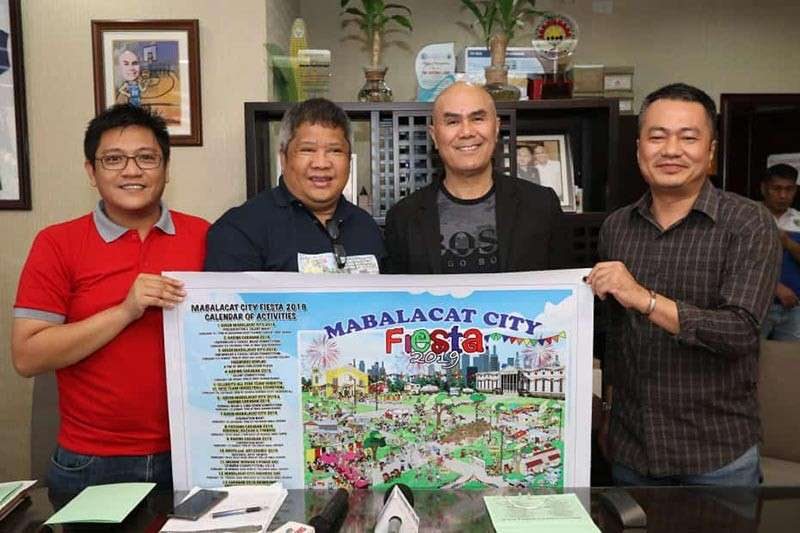 PAMPANGA. Fiesta 2019 Chairman Mabalacat City Mayor Cris Garbo (2nd from right) together with Vice-Chairman Jun Magbalot (2nd from left), City Tourism Officer Arwin Lingat (left) and City Information Officer Dillon Dion (right) show the calendar of activities during the press conference at city hall Thursday, February 7. (Chris Navarro)