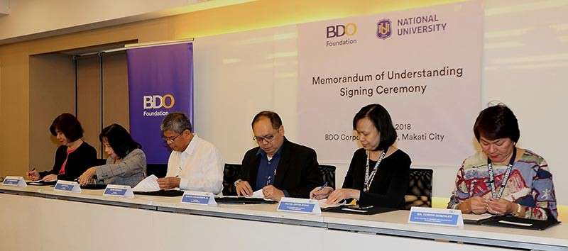 FARMING FINANCES. Officers of BDO Foundation and National University sign the memorandum of understanding to develop simple accounting and bookkeeping modules for farmers. (Contributed photo)