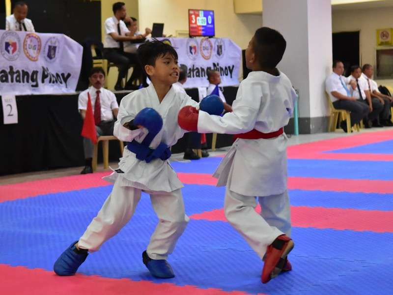 Jireh Nehemiel Badilles of Davao City, left, competes against Matthew Besonda of   Mati City in the kumite boys 10-11 finals of the Batang Pinoy 2019 Mindanao Qualifying   Leg karatedo competition at NCCC Mall in Tagum City yesterday, February 7. (Macky Lim)