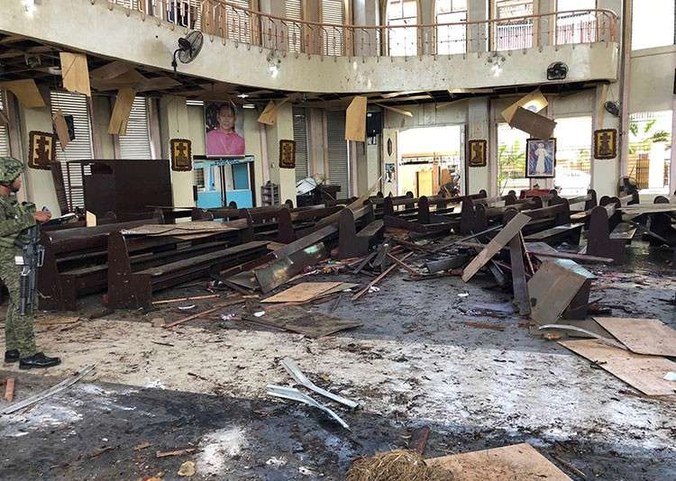 SULU. In this January 27, 2019, file photo provided by Wesmincom Armed Forces of the Philippines, a soldier views the site inside a Roman Catholic cathedral in Jolo, Sulu, after two bombs exploded. (AP)