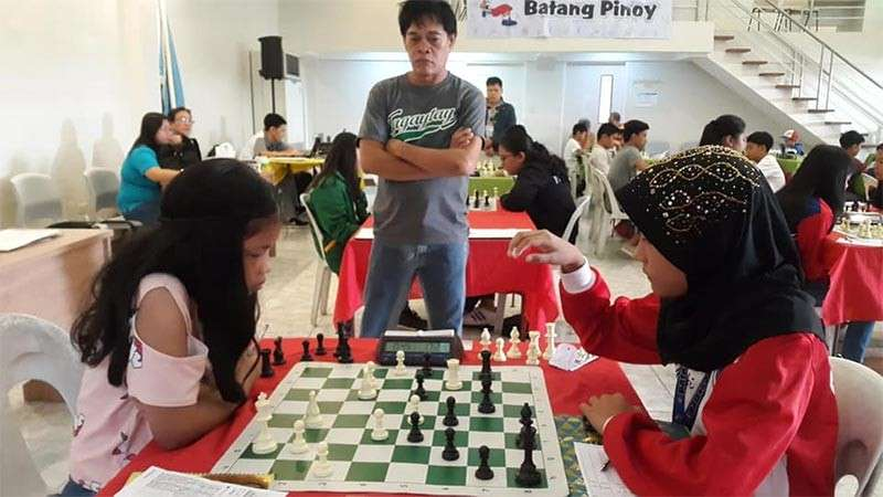 "TAGUM CITY. Little ""Tawing"" Canino, left, of Cagayan de Oro chess team already secures a special place in Batang Pinoy Games by her two-gold finish and a chance to sweep the golds in the 12-under girls bracket by capping her campaign in blitz event. (Contributed photo)"