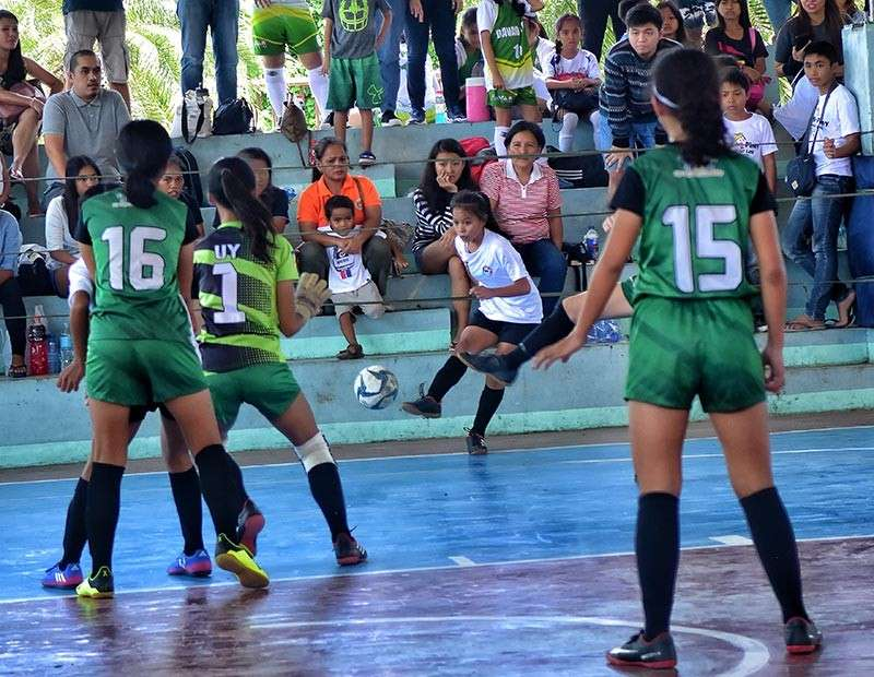 TAGUM CITY. Cielo Camangyan scores two goals to help Davao City girls 15-under futsal team beat Cagayan de Oro City, 2-1, during yesterday's championship game at Barangay San Miguel gym in Tagum City. Davao City also swept the boys 15-under, girls 13-under and boys 13-under futsal golds of the Batang Pinoy 2019 Mindanao Qualifying Leg. (Macky Lim)