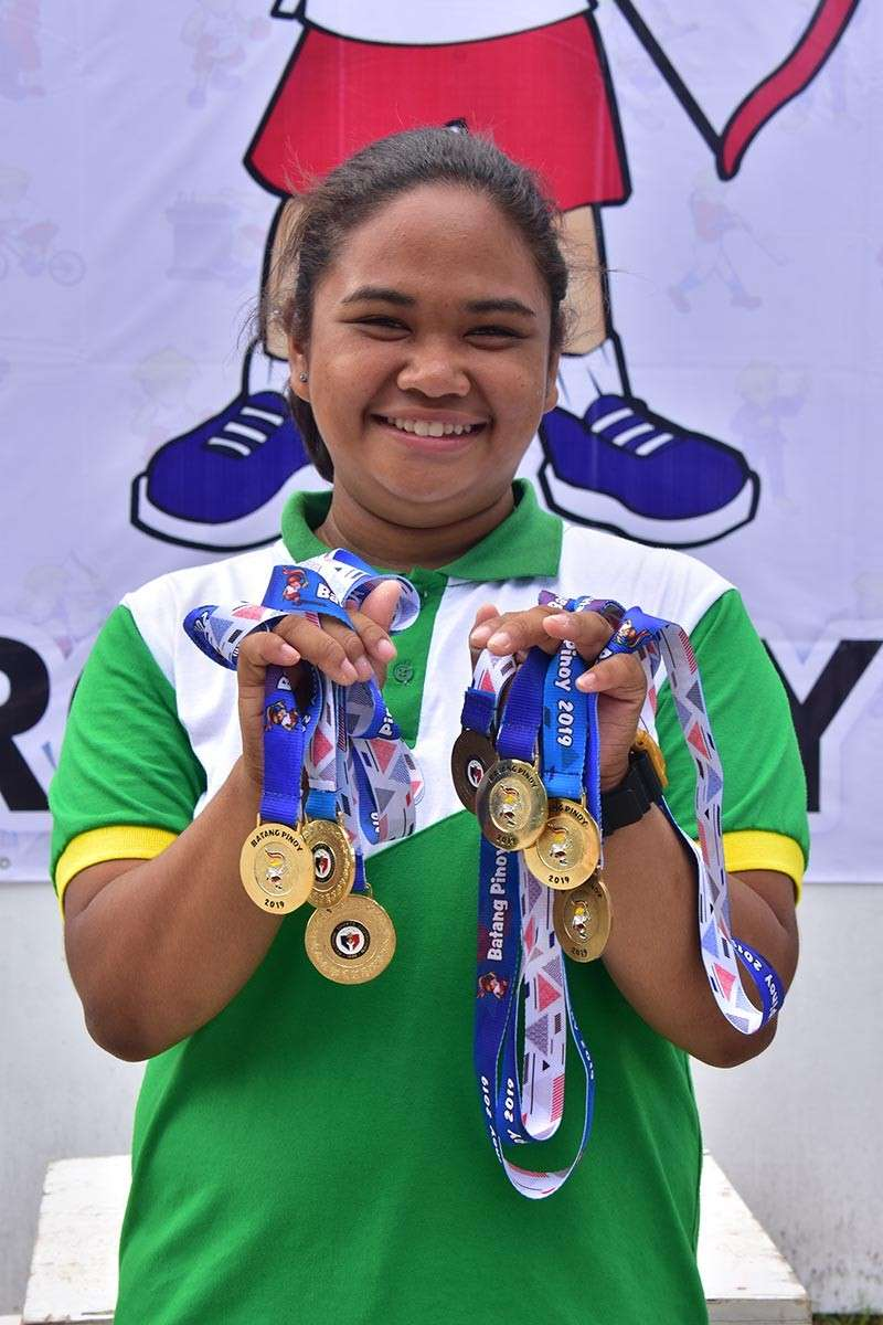 TAGUM CITY. Fourteen-year-old Kristine Adeline Ibag of Davao City shows her five gold medals and two bronzes at the close of the Batang Pinoy 2019 Mindanao Qualifying Leg archery competition at Davao del Norte Sports and Tourism Complex in Tagum City Friday, February 8, 2019. (Macky Lim)