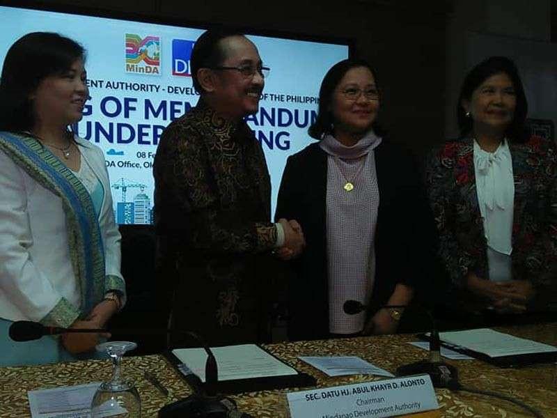 DAVAO. Minda secretary Datu Abdul Khayr Dangcak Alonto and DBP CEO and President Cecilia Borromeo after signing memorandum of understanding. (Contributed photo)
