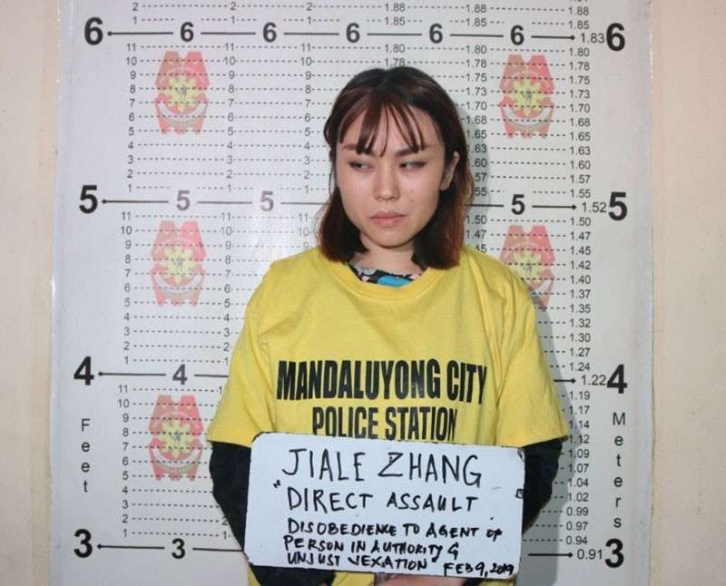MANILA. Chinese citizen Jiale Zhang is booked for direct assault, disrespect to an agent of a person in authority and unjust vexation for throwing a cup of taho (soya pudding) at a police officer who barred her from bringing it into the MRT Boni Avenue station on February 9, 2019. (Photo from NCR Police Office)
