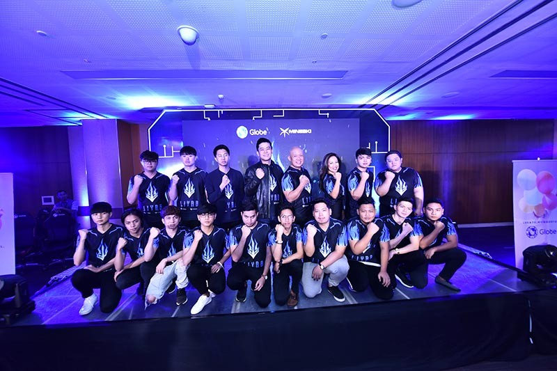 "Globe Telecom, in partnership with Mineski, made the next big move in the competitive eSports arena by launching a professional eSports team called ""Liyab,"" which will be debuting with teams from world-renowned eSports titles - League of Legends,  Hearthstone, and the 30th Southeast Asian Games (SEA) new medal game, Arena of Valor. Leading the launch were Globe President & CEO Ernest Cu, Mineski CEO and president Ronald Robins and Globe vice president for content partnerships, Jil Go. Also introduced were the players of Team Liyab consisting of 13 members, each with their own specialties in various prestigious eSports competitions. (Contributed photo)"