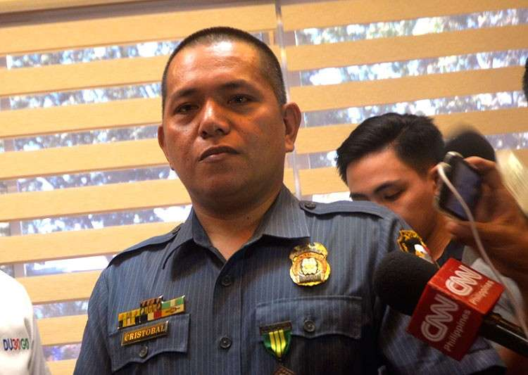 MANILA. Police Officer 1 William Cristobal receives Monday, February 11, 2019, the